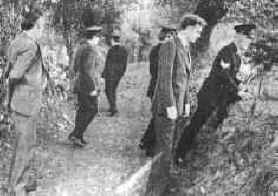 Plain clothes detective John Courtney, Dublin Murder Squad, pictured second from right, with other detectives and uniformed Gardai in the lane where Seamus Ludlow was murdered. The photograph dates from the day after the crime was committed.